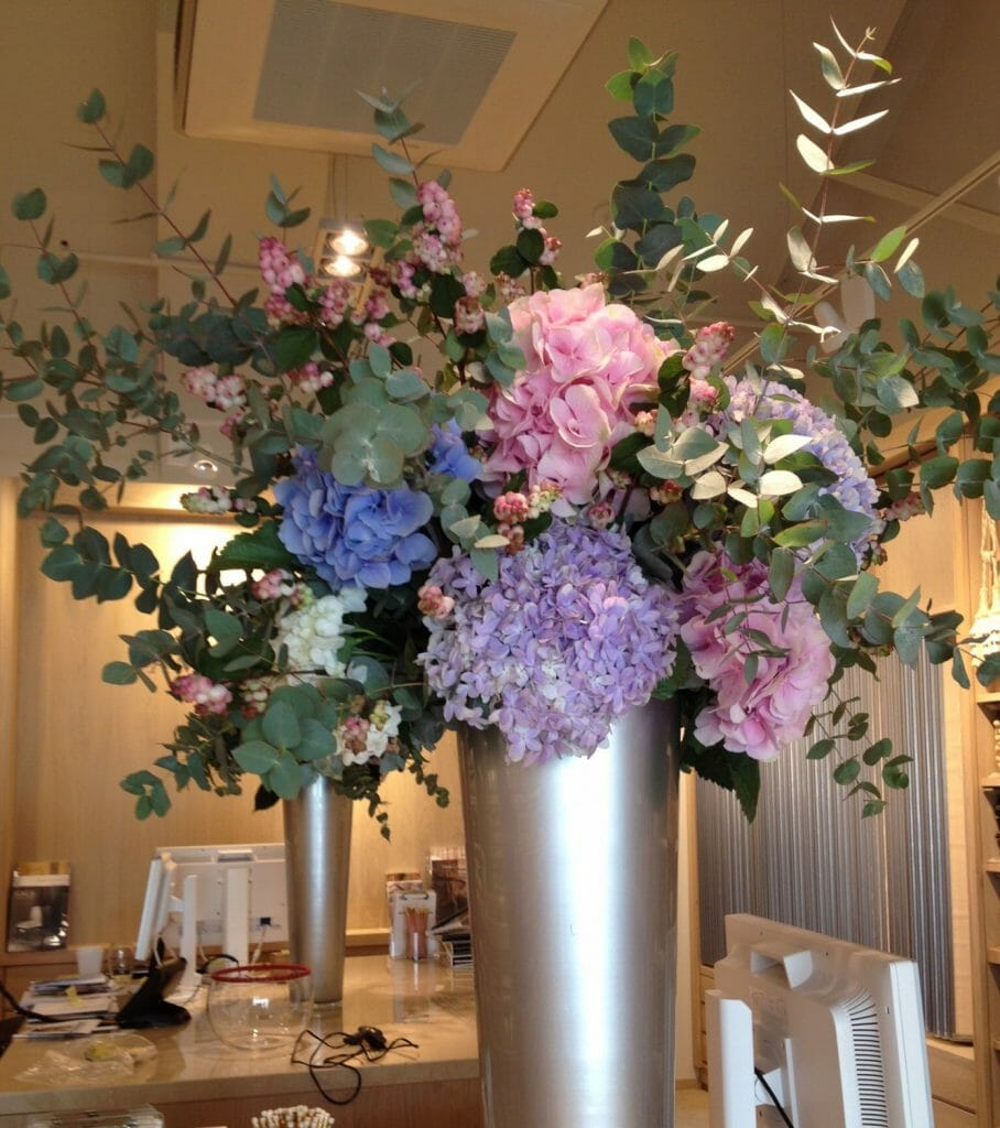 Photo showing a sample of a Corporate Vase Arrangement - Hydrangeas en masse. Kensington flowers, London