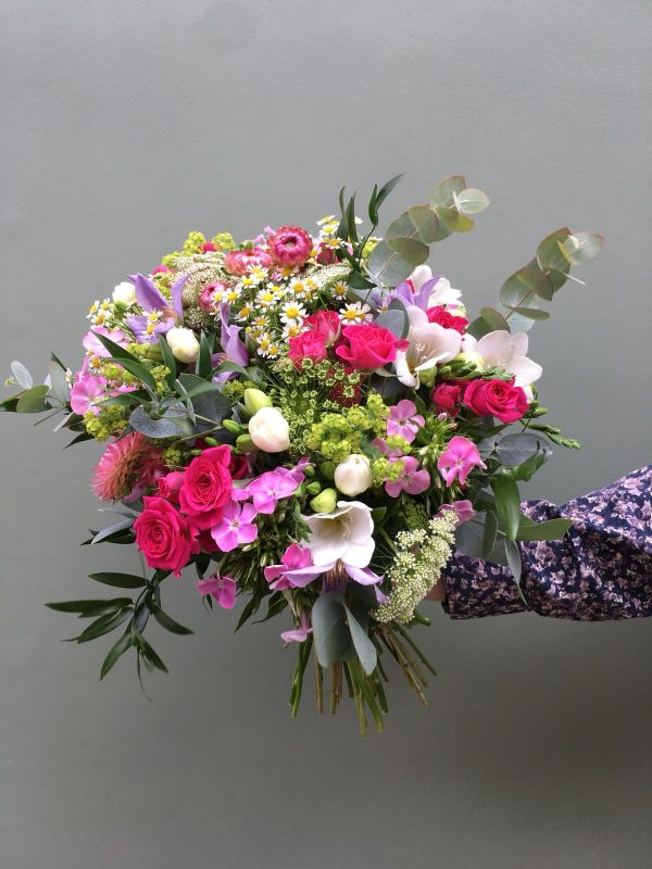 Photo showing a sample of a seasonal mixed colour hand tied bouquet available from Kensington flowers London
