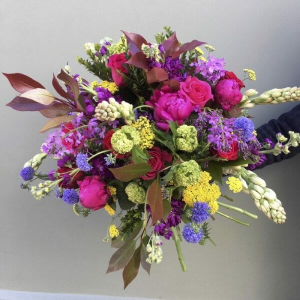 Photo showing a sample of a Seasonal hand tied bouquet mixed colours available from Kensington flowers London