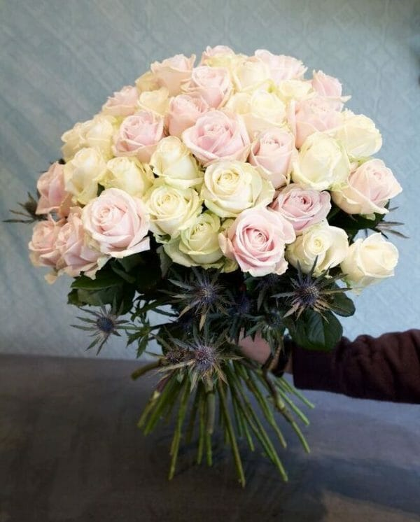 Photo showing a sample of a Classic rose bouquet, pink and white avalanche roses available from Kensington flowers, London