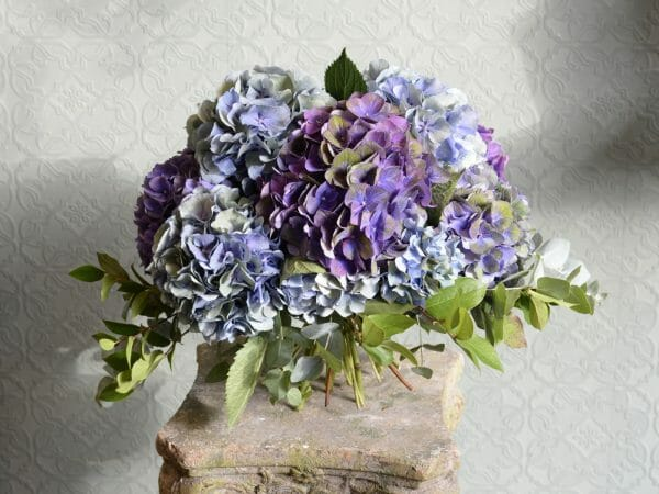 Photo showing a sample of a blue Hydrangea Studio Choice Bouquet Kensington flowers, London