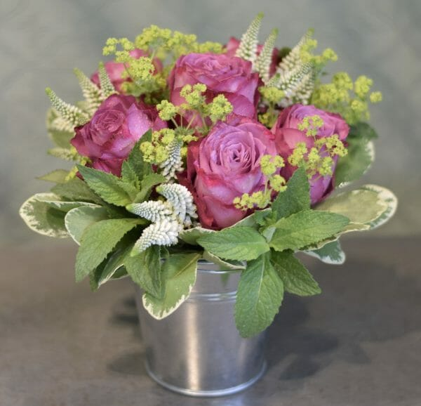 Photo showing a sample of a small Bucket of flowers from Kensington flowers.
