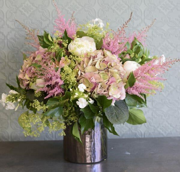 Photo showing a sample of a Studio choice vase arrangement, summer peonies, hydrangeas and astilbe pastel colours. Kensington flowers, London
