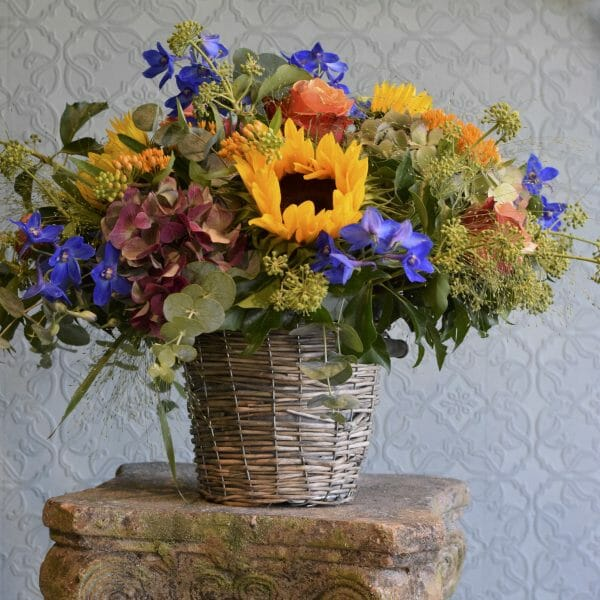 Photo showing a sample image of a bucket of flowers in mixed and vivid colours available to order from Kensington flowers, London