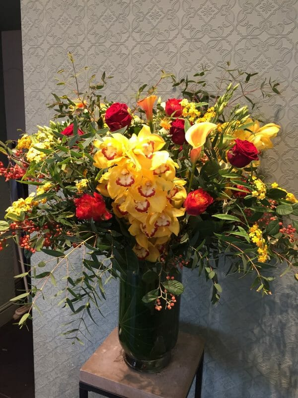Photo showing a sample of a luxury Seasonal classic vase arrangement, available to order from Kensington Flowers London