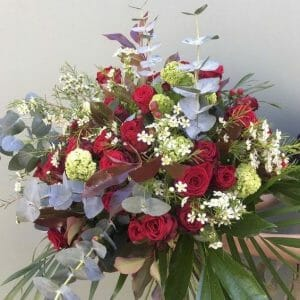 Photo showing a sample of a Classic red rose bouquet mixed colours available to order from Kensington flowers London