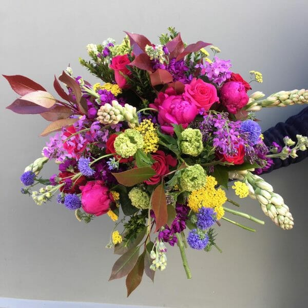 Photograph of a vivid scented garden bouquet available from Kensington Flowers London