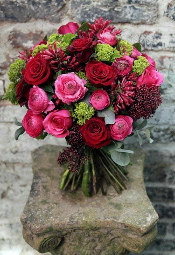 Photo showing a sample of a vivid Seasonal Hand Tied Bouquet Kensington Flowers
