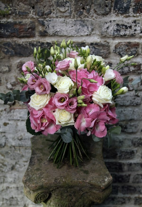 Photo showing a sample of a pink and white Seasonal Hand Tied Bouquet Kensington Flowers