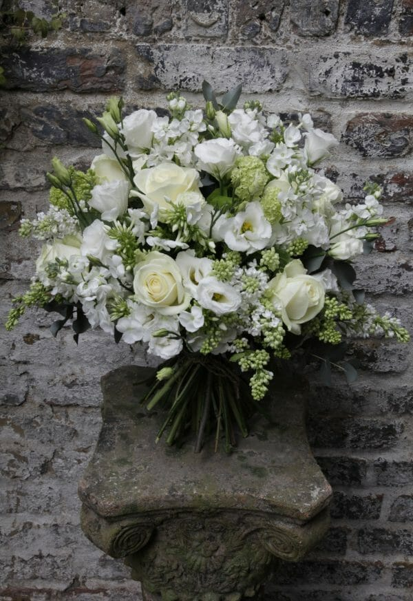 Photo showing a sample of a white Seasonal Hand Tied Bouquet Kensington Flowers