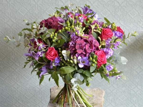 Photo showing a sample of a pink shades Seasonal Hand Tied Bouquet Kensington Flowers