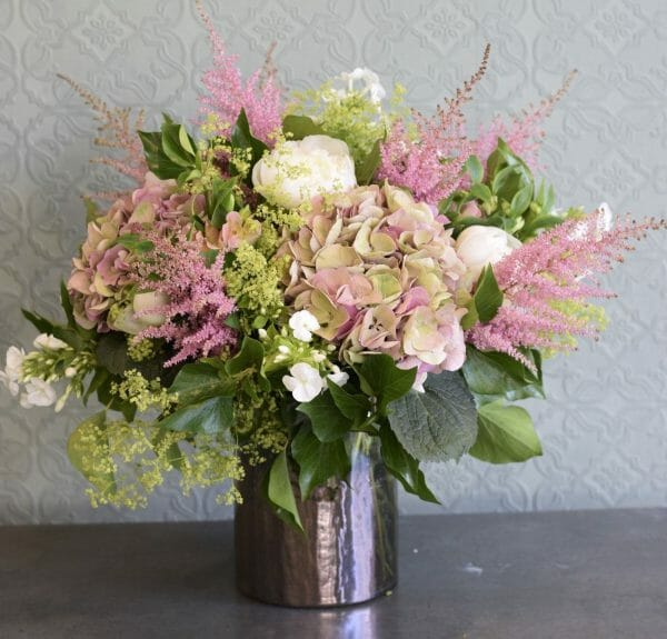 Photo showing a sample of a Seasonal classic vase arrangement, available to order from Kensington Flowers London