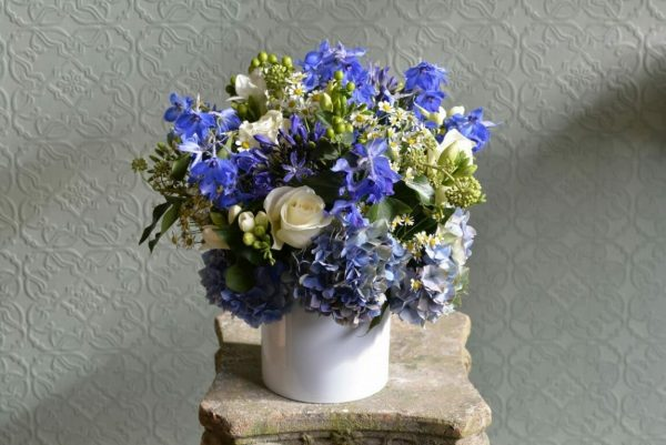 Photo showing a sample of a Seasonal Classic Vase Arrangement - summer blue and white colours - Kensington flowers, London