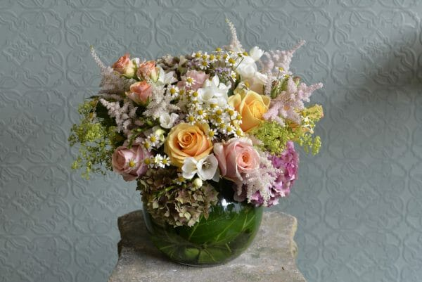 Photo showing a sample of a Seasonal Classic Vase Arrangement - summer mixed pastel colours - Kensington flowers, London