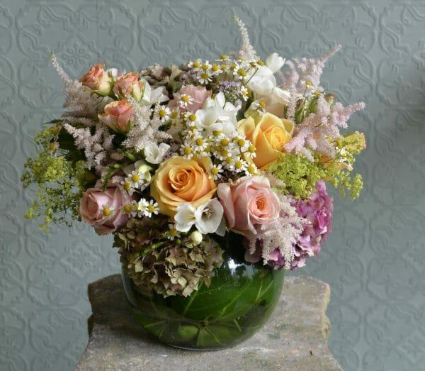 Photo showing a sample of a Seasonal Classic Vase Arrangement - summer mixed pastel colours - Kensington flowers, London