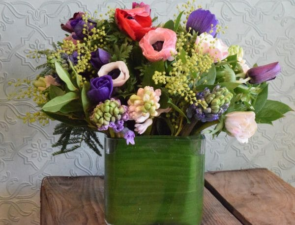 Seasonal spring vase arrangement of mixed colours available from Kensington flowers, London