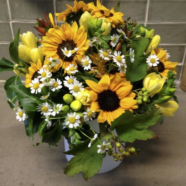 Scented garden vase arrangement of sunflowers, freesia vase arrangement Kensington flowers