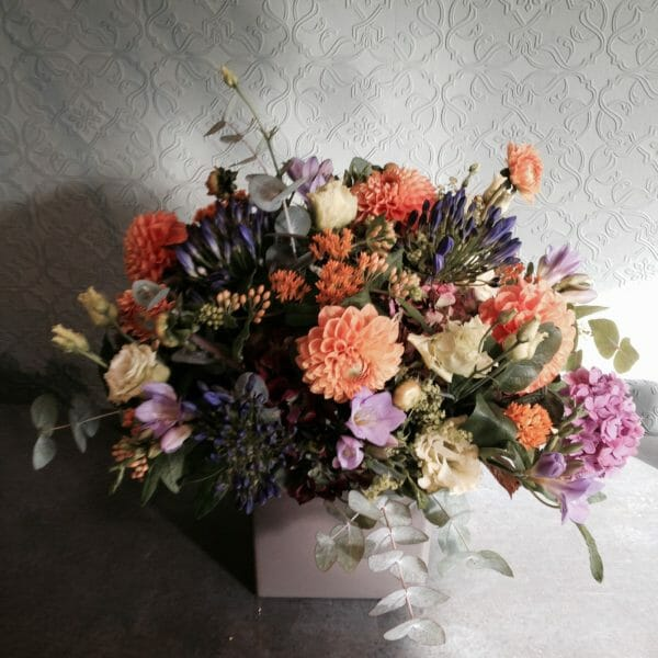Photo showing a sample of a Studio florist choice Vase Arrangement - late summer mixed colours - Kensington flowers, London