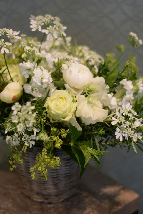 Photo showing a sample of a white bucket-of-flowers, Kensington flowers, London