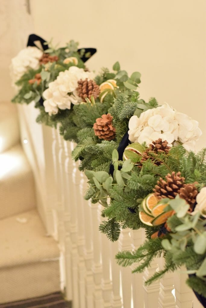 Christmas Stair garland of hydrangea, fruits, cinnamon, mixed foliage and pine Kensington flowers