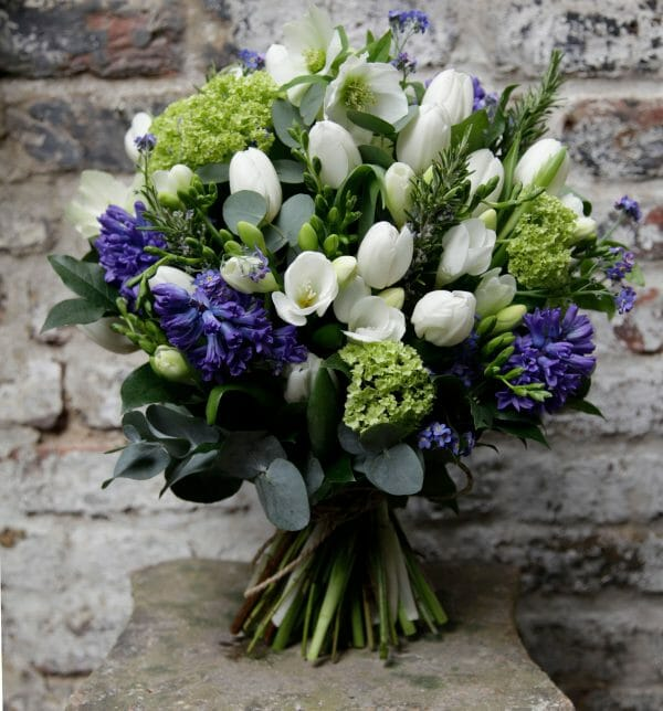 Photo showing a sample of a seasonal bouquet of spring purple white bouquet from Kensington flowers, London