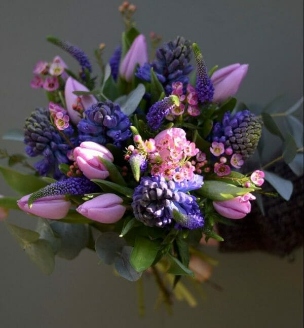 Photo showing a pink and purple/blue Spring Bouquet available to order from Kensington flowers, London
