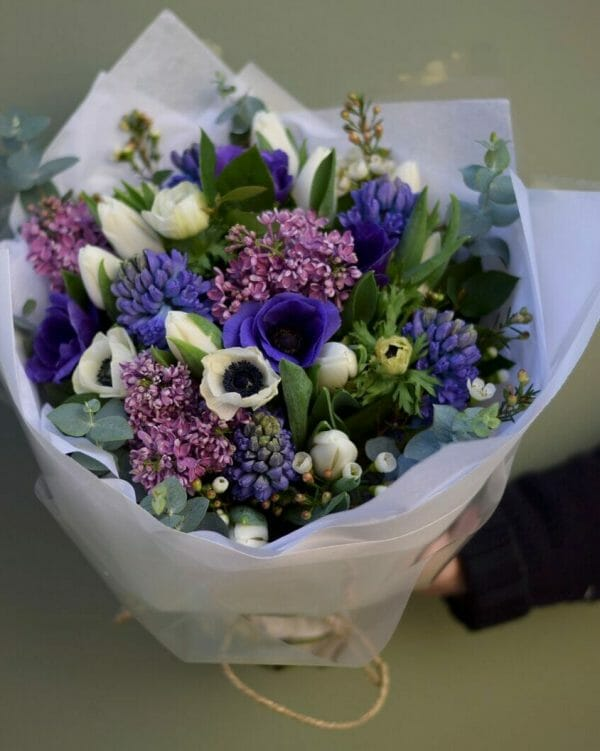 Photo showing a white and purple/blue Spring Bouquet available to order from Kensington flowers, London