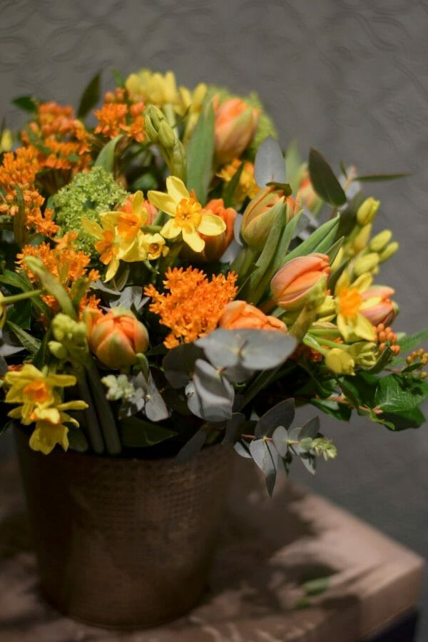 Tin/bucket of flowers orange and yellow spring seasonal flowers available for Kensington flowers, London