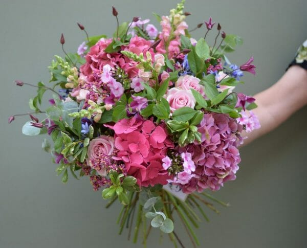 Photo showing a sample of a Seasonal rose bouquet in pink shades Kensington flowers