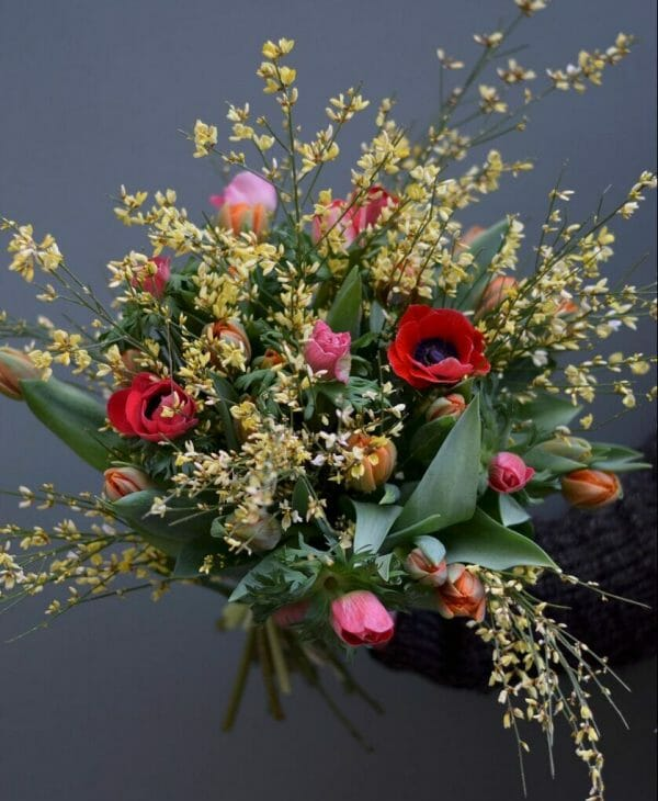 Photo showing a mixed colour Spring Bouquet available to order from Kensington flowers, London