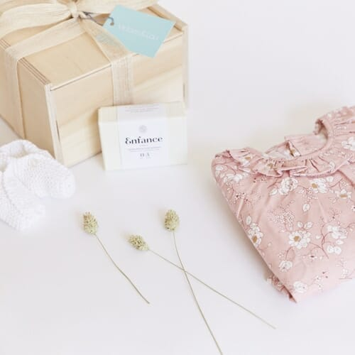 Photo showing sample of a Victoire & Lou - Welcome Baby Girl gift Box, including an Amaia Baby shirt with an Enfance organic Soothing Soap available from Kensington Flowers