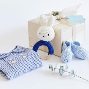 Photo showing Victoire & Lou gift box, delivered with flowers as a beautiful gift. The Welcome Baby Boy Gift Box Included in the box: Amaia Baby shirt (6 months) with a handmade rattle