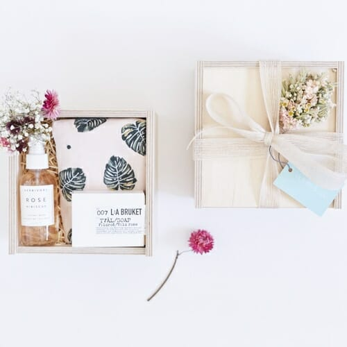 Photo showing a sample of Victoire & Lou Beauty gift box, delivered with flowers as a beautiful gift. The Beauty Gift Box - Rose pouch, mild soap and rose hydrating mist available at Kensington flowers