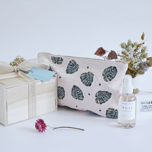 Photo showing a sample of Victoire & Lou Beauty gift box, delivered with flowers as a beautiful gift. The Beauty Gift Box - Rose pouch, mild soap and rose hydrating mist available at Kensington flowers London