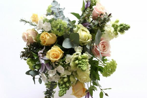 Photo showing a pastel mix colour rose bouquet of flowers available from Kensington flowers