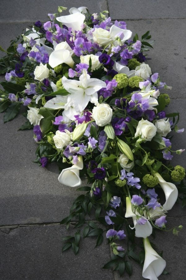 Photo of a Funeral floral tribute White and purple flowers spray arrangement Kensington Flowers