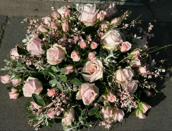 Photo of a pink funeral flowers Posy sympathy tribute arrangement Kensington flowers