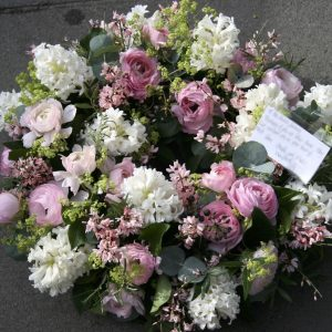 Photo of a pink and white Funeral wreath sympathy tribute