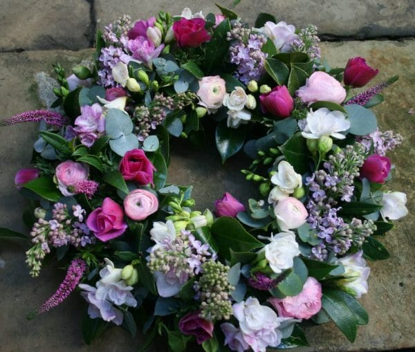 Photo showing a Wreath funeral flowers tribute Pink spring flowers Kensington flowers