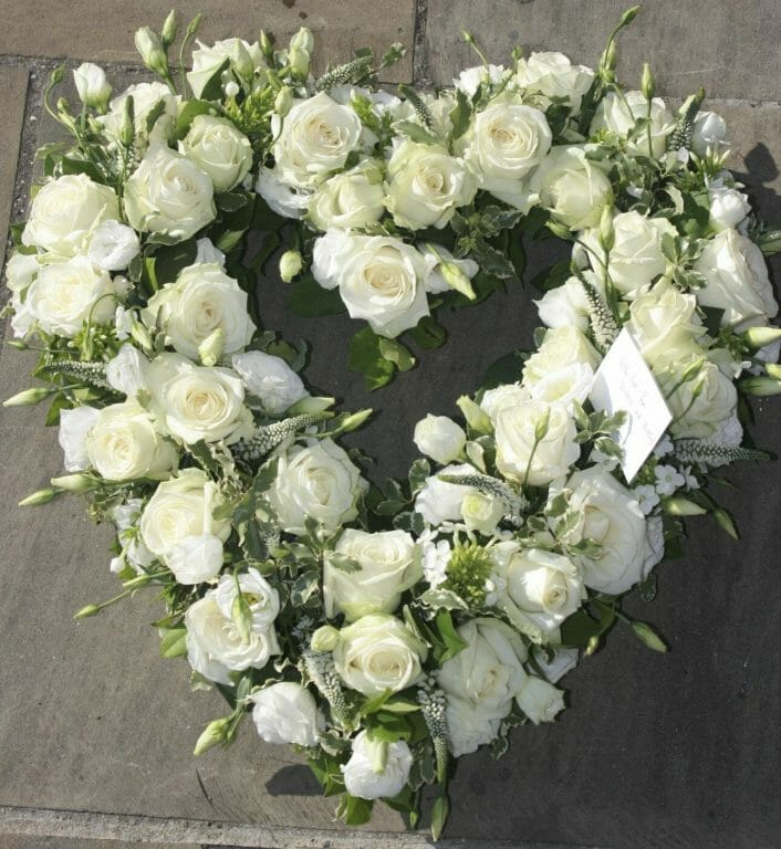 Photo of a all White open heart funeral tribute from Kensington Flowers
