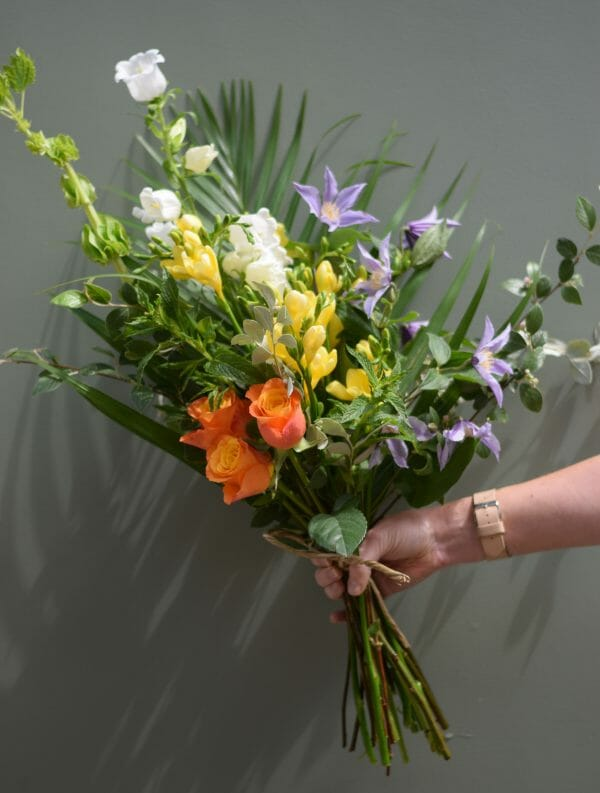 A photo showing a sample bouquet of a Handful flowers bunch mixed colours Kensington flowers