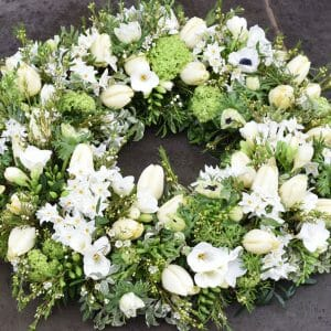 Photo showing a sample of a White funeral wreath tribute available at Kensington flowers London