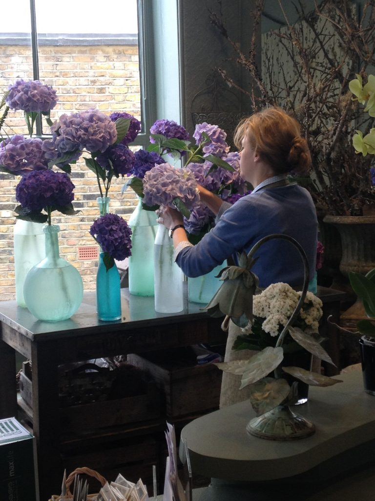 photo of a florist at work at Kensington flowers London