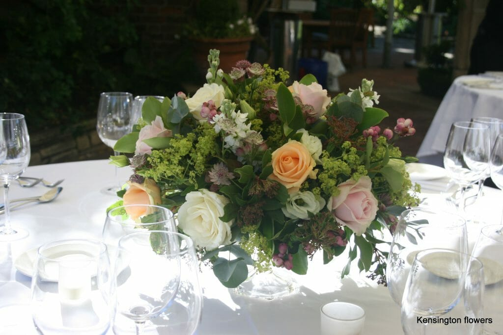 Photo showing a footed bowl floral decoration created by Kensington flowers