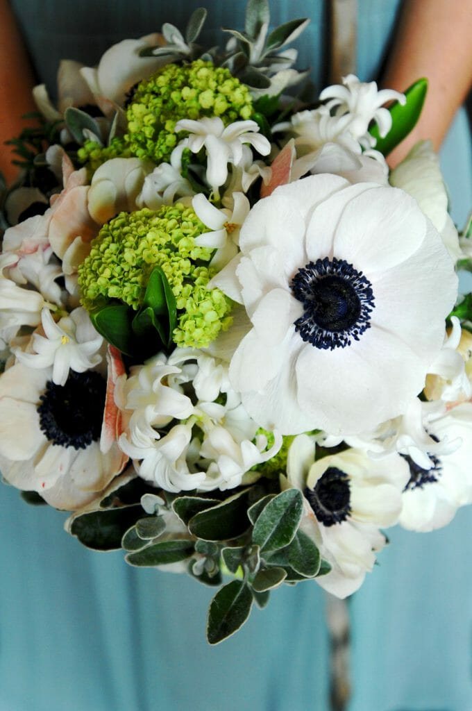 Photo of a Spring flower wedding bouquet, all white flowers created by Kensington flowers