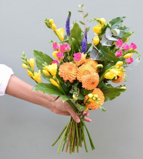 Photo showing a sample of A Handful bunch of flowers in mixed vivid colours available at Kensington flowers