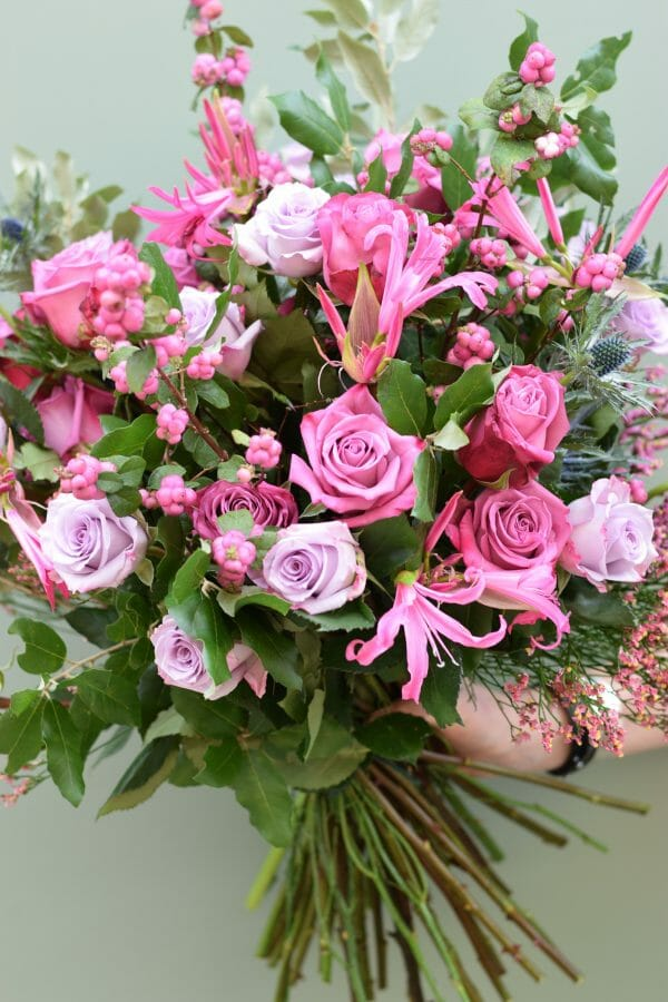 Photo showing a Seasonal rose bouquet in pink shades available from Kensington flowers