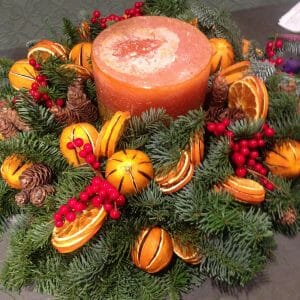 Christmas scented candle arrangement orange multi wick available to order from Kensington flowers London
