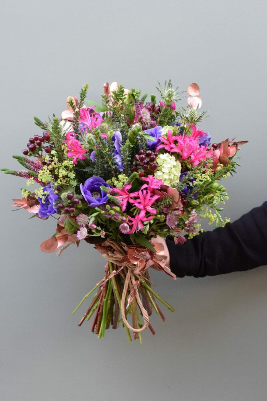 Christmas flowers of seasonal greens and jewel colours available from Kensington Flowers London