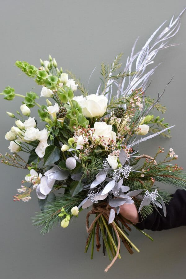 Christmas bouquet of seasonal greens and whites available from Kensington Flowers London